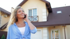 Happy girl talking on the phone, taking selfie. New house - stock footage