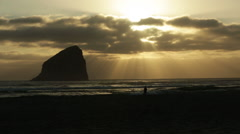 BEAUTIFUL SUNSET ON OREGON COAST WITH ROCK FORMATION SILHOUETTED Stock Footage