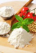 Wheat flour on wooden board Stock Photos