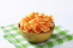 Bowl of bacon-flavored puffed wheat chips Stock Photos