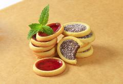 Mini tarts with jam and chocolate coconut filling Stock Photos