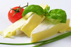 Brique cheese - soft cow's milk cheese with thin edible rind - stock photo