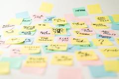 Stock Photo of Multicolored paper stickers on wall