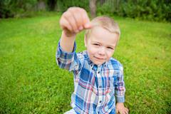 Happy little boy showing something Stock Photos