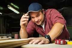 Professional carpenter at work. - stock photo