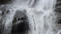 Water falling down cascading over rocks Stock Footage