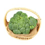 Green broccoli in a wicker basket isolated Stock Photos