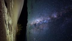 Astrophotography Time Lapse of Milky Way rising over Desert Dunes -Vertical Pan- Stock Footage