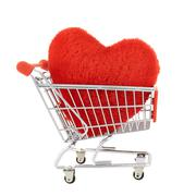 Plush toy heart in a shopping cart - stock photo