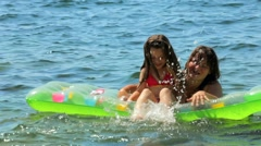 Leave Mom and daughter on the sea - stock footage
