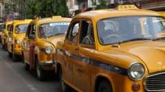 Yellow Ambassador cabs waiting on street,Kolkata,India Stock Footage