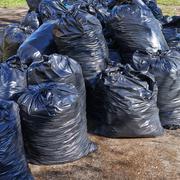 Pile of black garbage bags Stock Photos