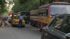 Busy traffic and yellow Ambassador cabs,Kolkata,India Stock Footage