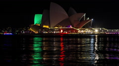 Sydney Opera House VIVID over water reflections spectacular light show Stock Footage