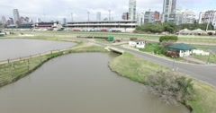 Aerial scene from hippodrome lakes, to stadium and ending with cityscape. Stock Footage