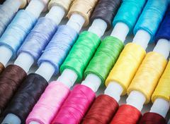 Multicolor sewing threads on background Stock Photos