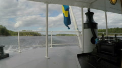 Bow of Steamboat in Stockholm archipelago: Swedish Flag Stock Footage