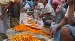 Close up of orange flower sellers,Kolkata,India Stock Footage