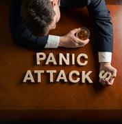 Phrase Panic Attacks and devastated man composition - stock photo