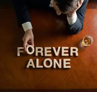 Phrase Forever Alone and devastated man composition Stock Photos