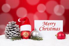 Merry Christmas card with snow, ornaments, balls, hat decoration - stock photo