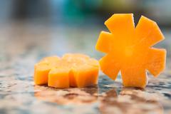 Carrot slices isolated on a granite - stock photo
