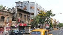 White Mother Teresa house on busy street,Kolkata,India Stock Footage