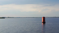 Red buoy on the river Stock Footage