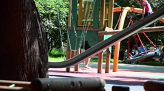 The child moves out of children's slides Stock Footage