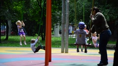 Stock Video Footage of children swinging on a swing