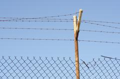 Damaged Barb wire fence - stock photo