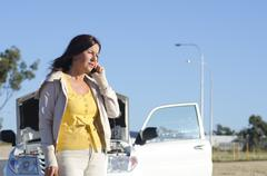 Woman car breakdown road assistance Stock Photos