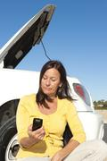 Woman calling road assistance - stock photo