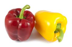 Red and yellow sweet peppers paprika isolated on white background Stock Photos