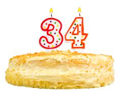 Birthday cake candles number thirty four isolated Stock Photos