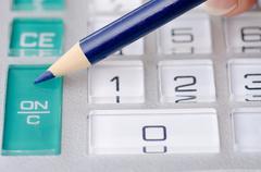 Calculator and pen adding accountant figures Stock Photos