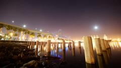 Motion Control Time Lapse of Moonrise over Bridge & Container Ship at Port of LA - stock footage