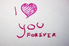 Inscription I love you forever lipstick - stock photo