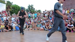 A breakdancer performing downrock. Stock Footage