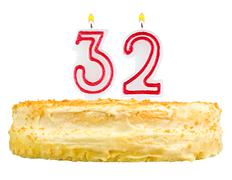 birthday cake with candles number thirty two - stock photo