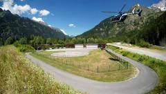 Helicopter landing in the mountain alpine valley Stock Footage