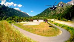 Rescue helicopter landing in the mountain alpine meadow Stock Footage