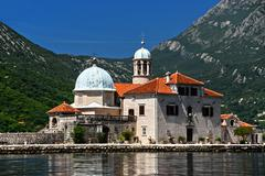 Our Lady of the Rocks, one of the two islets off the coast of Perast in Bay o - stock photo