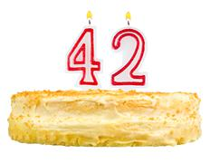 birthday cake with candles number forty two - stock photo