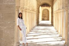 Confident sexy mature woman standing archway - stock photo