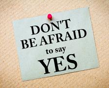Don't Be Afraid To Say YES Message written on paper note - stock photo