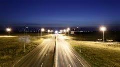 Speed Traffic at Sundown Time - light trails on motorway highway at night - stock footage
