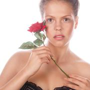 Portrait of teen girl with rose flower and nude makeup. - stock photo