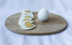 boiled eggs on a chopping board - stock photo