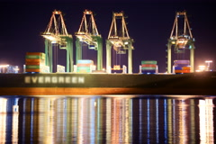 6K Time Lapse of Cranes Loading on Container Ship at Port of LA Stock Footage